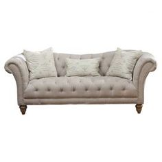 "Highlighted by diamond-tufted upholstery and rolled arms, this elegant hardwood sofa brings a touch of rich style to your living room or library.      Product: Sofa   Construction Material: Hardwood, hemp and polyester   Color: Ivory   Features: Spring suspensionThree pillows includedDiamond-tuftedRolled arms Dimensions: Seat: 19.5"" H x 78"" WOverall: 34"" H x 92"" W x 36"" D"