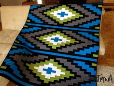 Katrina of Ugly Quilts Live Here just finished this amazing rug quilt from a pattern, Spanish Textile by J. She said she added visual interest to the seams using a zig zag stitch. Bargello Quilts, Lap Quilts, Quilt Blocks, Southwestern Quilts, Southwest Style, Native American Patterns, Indian Quilt, Geometric Quilt, How To Finish A Quilt