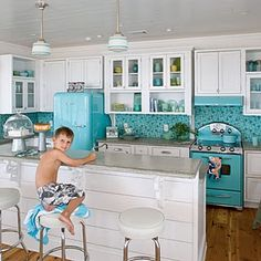 Turquoise I would totally rock turquoise appliances...  Love it