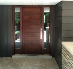 """This showstopping minimalist #Amberwood custom mahogany #door, with 2 clear beveled glass sidelights features horizontal planks with .25"""" grooves! The contemporary entrance is finished with a lovely San Miguel stain and linear #EmtekLuganoHardware in Satin Nickel! Call or come into Amberwood's outstanding showroom today and discover your dream doors! 416-213-8007 #AmberwoodDoors proudly ships throughout the #USA! Call today for shipping details! 1-800-861-3591"""