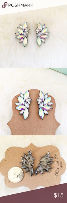 ⭐️ 2/$20 ⭐️ Iridescent Fan Earrings Iridescent crystal fan earrings. Gorgeous, super sparkly, iridescent crystal, fan shaped earrings. Gunmetal colored setting. These earrings are utterly fabulous and great quality. ⭐️ 2/$20 ⭐️ BUNDLE 2 PAIR AND OFFER $20 OR JUST ASK AND I'LL CREATE A CUSTOM BUNDLE Jewelry Earrings
