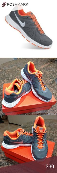 pretty nice e20c9 f7706 Shop Men s Nike Orange Gray size 12 Athletic Shoes at a discounted price at  Poshmark. Description  Men s Nike Revolution 2 Athletic shoes Size  12 ...