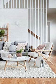 If you want a Scandinavian living room design, there are some things that you should consider and implement for this interior style. Wood as a material has an important role as well as light colors, because they give the living… Continue Reading → Living Room Interior, Home Living Room, Home Interior Design, Living Room Designs, Living Room Decor, Scandinavian Interior Living Room, Living Room With Grey Sofa, Staircase In Living Room, Neutral Living Rooms