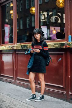 Black mini skirt and high tops