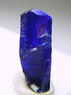 A transparent crystal of deep blue Linarite. It really shows the transparency when backlit.  It is a pretty big piece for Linarite, that usu...