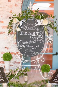 Hand-lettered sign decor with roses.  (Design by Lee Forrest Design, photo by: Amalie Orrange Photography)