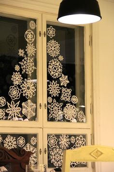 Dispel the winter darkness with Cheerful Paper Snowflakes on the window glass (from villi piha blog)