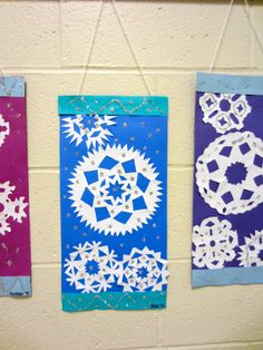 Kirigami Snowflake banners.  I made these last year and they got rave reviews when on display in the hall.