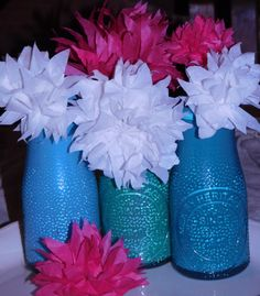 tissue paper flowers in painted milk bottles