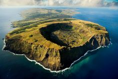 Rano Kau volcano in Rapa Nui National Park, Easter Island, Chile - Photograph by YANN ARTHUS BERTRAND For me, the allure of aerial photography is the unique perspective it gives. Places To Travel, Places To See, Château De Villandry, Foto Nature, Places Around The World, Around The Worlds, Easter Island, Parc National, Aerial Photography