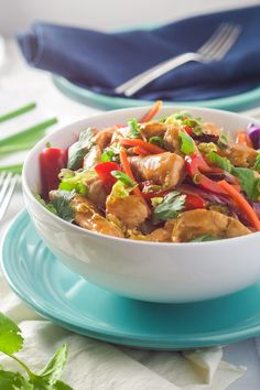 Honey Sriracha Chicken Rice Noodle Bowls are filled with chicken and stir fried vegetables, smothered in a sweet and spicy sauce; all over a big bowl of rice noodles!