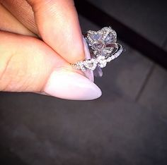 """Lady Gaga posted a close-up Instagram of her sparkler on Wednesday, Feb. 18, with the caption: """"My favorite part of my engagement ring, Taylor and Lorraine designed """"T S"""" in white diamonds on the band. He always called me by my birth name. Since our very first date. I'm such a happy bride-to-be! I can't stop smiling!!"""""""
