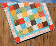 Bright Baby Boy Lollipop Quilt Red Yellow Blue Orange Green Brown Blanket by JennyMsQuilts on Etsy https://www.etsy.com/listing/121930920/bright-baby-boy-lollipop-quilt-red
