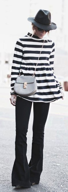 5110ec3e1539 70's Trend: Mary Seng is wearing a striped top from Free People, flare jeans