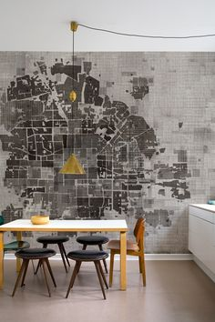 This one is a little too abstract for my tastes, but the idea of a beautiful geometric street map as wallpaper is something I could very much get behind. I've already fallen in love with the idea of a map of the world as a floor, so why not this?