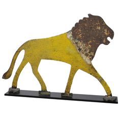 Cast Iron Lion Sign | From a unique collection of antique and modern animal sculptures at http://www.1stdibs.com/furniture/more-furniture-collectibles/animal-sculptures/