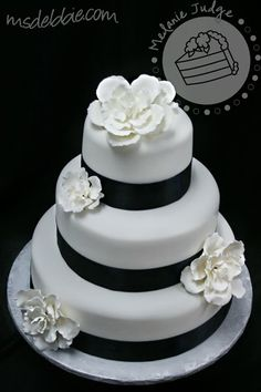 navy ribbon....could be beautiful as the bouquet handle! Paired with big peonies and gardenia. all white shiny shells?