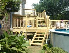 Fabulous two story deck to accompany an above ground pool.
