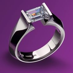 Micro Mango Earrings in yellow gold and diamonds    	  Gothic Ring in platinum with diamond