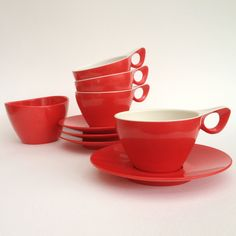 Flame red tea set: Melaware 4cups and saucers and a sugar bowl. £18.00, via Etsy.