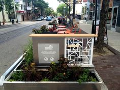 Planters ring the parklet creating a beautified buffer to separate the space from street traffic