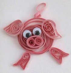 Quilled pig with googly eyes