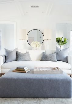 A massive gray ottoman makes for easy additional seating when guests come over!