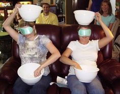 "The Cotton Ball Game' (pictured). ""Two guests (or more) at a time are blindfolded and try to spoon cotton balls from the bowl on their lap into the bowl held on top of their head. They only have 30 seconds to get as many in as possible. It's pretty tough Youth Group Games, Family Games, Adult Games, Adult Party Games Funny, Baby Shower Games Funny, Funny Games For Groups, Christmas Party Games, Funny Christmas Games, Xmas Games"
