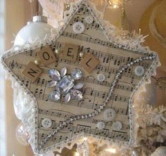 Christmas star collage from found objects: scrabble tiles, buttons, sheet music, jewelry, lace trim