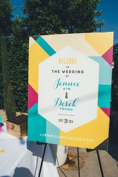 colorful wedding sign - photo by Christine Farah Photography http://ruffledblog.com/colorful-la-wedding-at-the-fig-house #geometric #weddingideas #signage