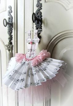 ballet style dress miniature is made from music sheets and crepe paper