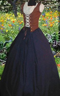 Beautiful silhouette and easy to imitate in a toned down way; high waisted skirt, any shirt or blouse, and a vest with ties in front. Gold.