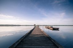 Check out Wooden pier in a lake. Sunrise by Irantzu Arbaizagoitia on Creative Market