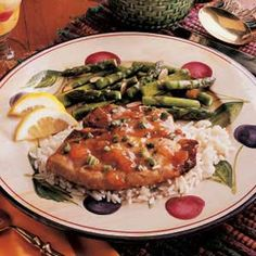 Asparagus with Almonds Recipe -This side will please the palates of everyone—even those who generally don't care for asparagus. I look forward to spring each year so I can make this tasty side dish.—Eileen Bechtel, Wainwright, Alberta