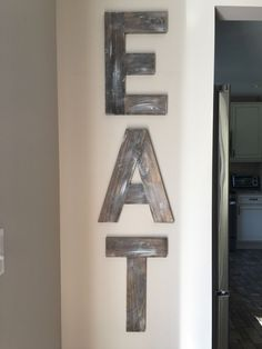 EAT Sign - wooden letters - wood decor - rustic decor - kitchen decor - dining room decor - wall art - large decor - distressed - reclaimed by thislittlebrickhouse on Etsy https://www.etsy.com/listing/472808627/eat-sign-wooden-letters-wood-decor