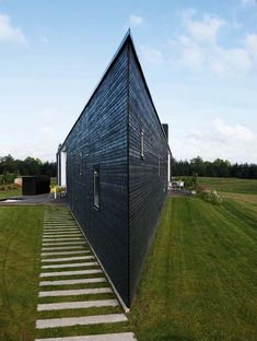 Triangular House Triangular home in Denmark for a young and happy family