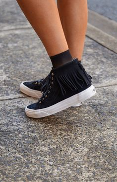 You'll be painting with all the colours of the wind when you're wearing theVans Sk8-Hi Moc Black Suede Sneakers. Made from a black suede fabric, the high-cut sneakers feature a lace up front with silver eyelet detail, waffle sole for extra grip and fringe detail on the ankles. Grab your fave mum jeans, a printed tee and leather jacket for an easy, breezy summer's day out. FABRICATION:Leather upperMan made liningMan made rubber sole SIZE:Sole measures 2cm