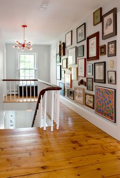 I love the collection of framed art, photos, etc. ..from floor to ceiling...very nicely done
