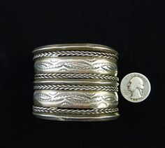 This is a stunningly WIDE Old Pawn vintage Navajo sterling silver bracelet…