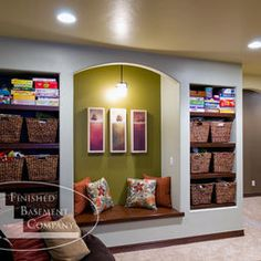 Basement Design - good use of hallway space.  Rather than a bookcase, use baskets.