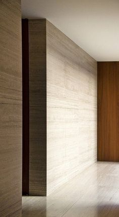 Textured. concrete walls with horizontal lines make it appear wooden. horizontal lines are restful.
