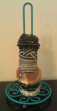 An antique paper towel holder used to store bracelets