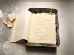 """Edible Cookbook - The Real Cookbook from German design agency Korefe is a """"delicious creation made of 100% fresh pasta. Flip it open for some toothsome inspiration, and tear out the pages to use as sheets of lasagna."""" Really??? Hmmmm...."""