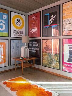 Troy Litten's San Fran home: artwork in the guest bedroom from his collection of photos of travel graphics and signage.