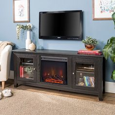 Add some warmth into your living space with this fireplace TV stand from Winmoor Home. With two adjustable side cabinets, a cable management system, and a beautiful electric fireplace insert, this TV stand is the perfect addition to every living room. Home, Living Room Tv, Wooden Tv Stands, Entertainment Center, Living Room Storage Cabinet, Tv Stand Brown, Fireplace Tv Stand, Traditional Fireplace, Saracina Home