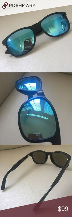 RAY-BAN blue black flash lens wayfarer sunglasses ( New listing. )Take a break from your typical wayfarer, clubmaster and aviator Ray-Bans and wear this flash lens one instead. Some tiny scratches on the lens but still has tons of life on it! Ray-Ban Accessories Sunglasses