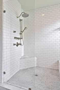 White subway tiles an affordable way to go all white. Floor is nice contrast and gives character for shower