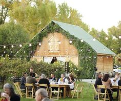 Twinkling lights were strung above the outdoor reception area, set up in front of 3 Oaks' vine-covered barn. Plan My Wedding, Our Wedding, Wedding Planning, Wedding Stuff, Wedding Ideas, Reception Areas, Wedding Reception, Rustic Wedding, Party On Garth
