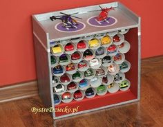 DIY baby garage made from toilet paper rolls and cardboard boxes - toilet paper roll crafts for kids Kids Car Garage, Toy Garage, Cardboard Box Crafts, Toilet Paper Roll Crafts, Toy Car Storage, Matchbox Car Storage, Diy For Kids, Crafts For Kids, Homemade Christmas Presents