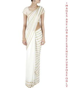 White sequin embellished sari. Featuring a yellow georgette sari fully hand embroidered with sequins in stripes pattern and contrast silk facing detail. It comes along with a sequin embroidered silk blouse piece. COMPOSITION: Viscose georgette, silk. CARE: Dryclean only. Size: Free